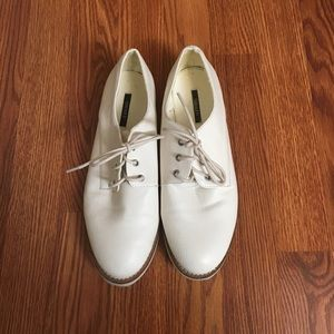 White tie up shoes